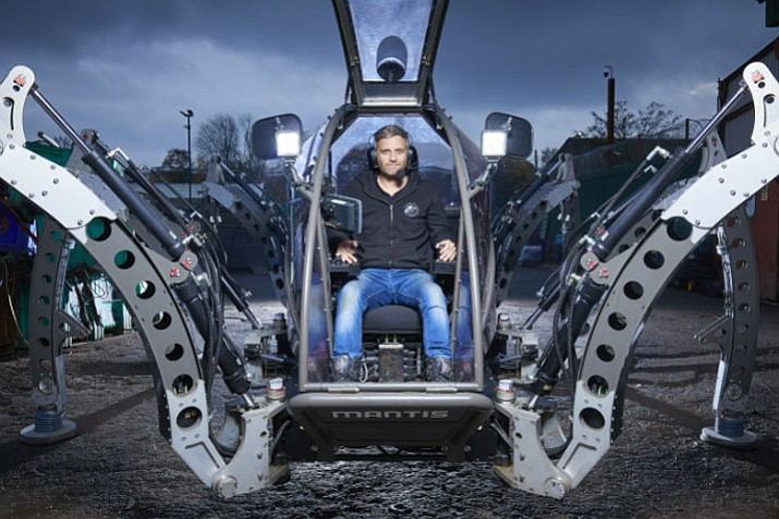 Matt Denton sites inside his 6-legged creation called Mantis. The hexapod robot can be driven from inside its cockpit or operated remotely by Wi-Fi. (Guinness World Records)