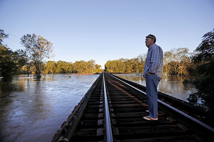 Charles Gardner checks the level of the Cape Fear River near his property after its projected time of cresting in Fayetteville, N.C., Wednesday, Sept. 19, 2018. (David Goldman/AP)