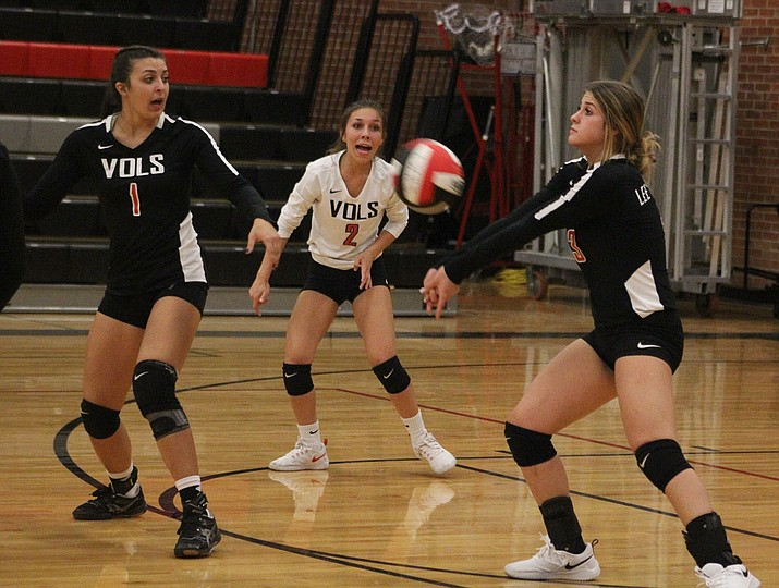 Lee Williams' Kyla Romeo, far right, tallied six digs, five kills and three blocks Tuesday night in a 3-2 loss to Prescott. (Photo by Beau Bearden/Daily Miner)