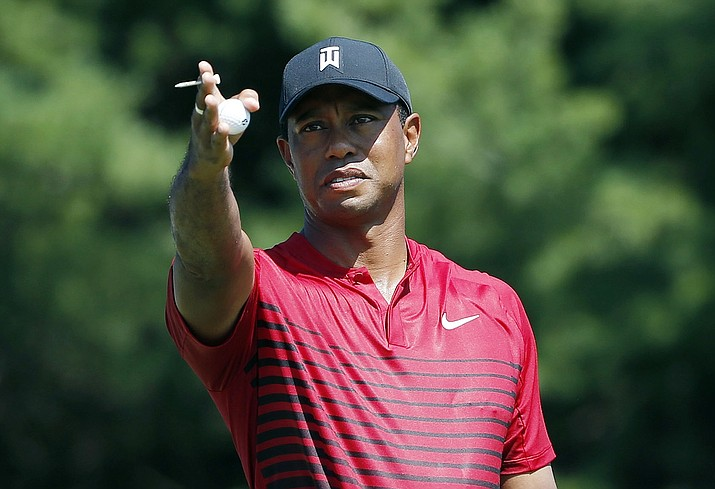 Tiger Woods indicates the direction of the wind before teeing off on the third hole during the final round of the Dell Technologies Championship golf tournament Sept. 3 at TPC Boston in Norton, Mass. Woods once took for granted that he would end his season at the Tour Championship. Now, just being at East Lake feels like an accomplishment. (Michael Dwyer/AP, file)