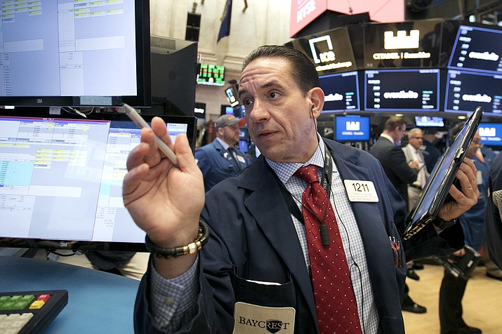 Trader Tommy Kalikas works on the floor of the New York Stock Exchange, Thursday, Sept. 20, 2018. A wave of buying sent U.S. stocks solidly higher on Wall Street Thursday, pushing the Dow Jones Industrial Average above the all-time high it closed at in January. (Richard Drew/AP)