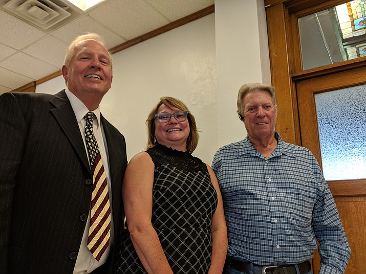 From left: Write-in candidates Ken Watkins, Deana Nelson and Harley Pettit outside the courtroom of Judge Lee Jantzen, who ruled the top four write-ins from the primary election should advance to November's ballot. (Photo by Travis Rains/Daily Miner)