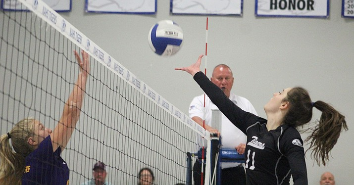 Kingman Academy's Grace Herbine tallied 16 kills and four blocks Thursday during a 3-1 win over Wickenburg. (Photo by Beau Bearden/Daily Miner)