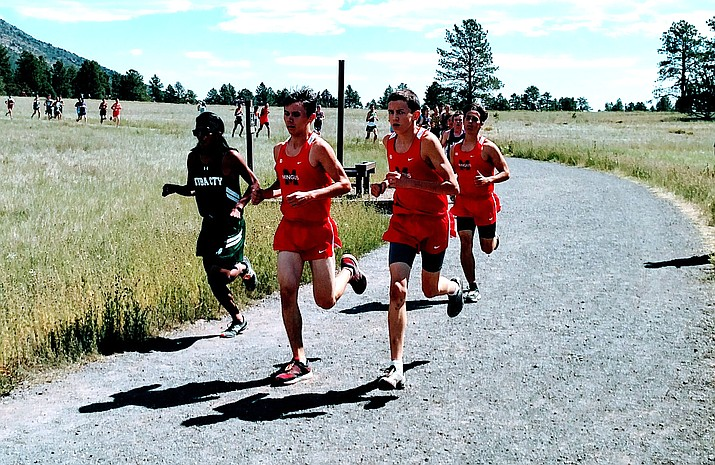 Sophomores Jehiah Rogers (left) and Riley Bliss (right) and senior Nick Lodico led the Mingus scoring effort in Saturday's Four Corners Invitational in Flagstaff.