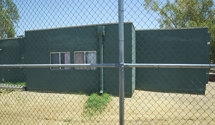 Buildings that house juveniles and operations on the grounds of Southwest Key Campbell, a shelter for children that have been separated form their parents in Phoenix, Ariz. are seen in this June 28, 2018, photo. Arizona officials have moved to revoke the licenses for the nonprofit that houses immigrant children after it missed a deadline to show that all its employees passed background checks. (Carolyn Kaster/AP file)