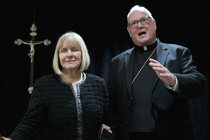 Cardinal Timothy Dolan addresses a news conference at the offices of the New York Archdiocese, in New York, Thursday, Sept. 20, 2018. The Roman Catholic Archdiocese of New York said Thursday that it has hired former federal judge Barbara Jones, left, to review its procedures and protocols for handling allegations of sexual abuse. (Richard Drew/AP)