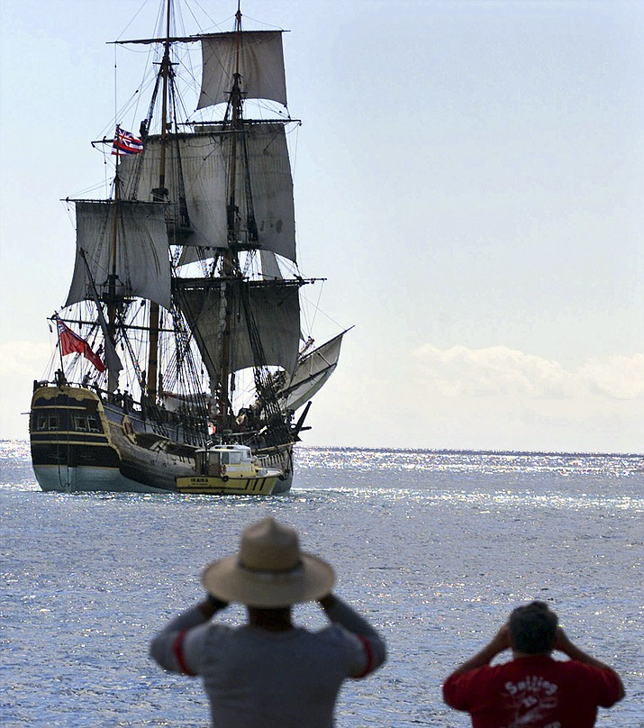 People watch as a replica of the HMB Endeavour leaves Honolulu on Nov. 15, 1999, as it embarks on a four-year, around-the-world cruise. The original vessel was commanded by Capt. James Cook in the 1700s when he became the first European to chart Australia's East Coast. (Ronen Zilberman, AP File)