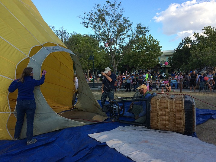 Sandy's Sol Balloon Team from Cornville begins inflating their hot air balloon Saturday, Sept. 22, 2018, as part of the Prescott Valley Rotary Club's Balloon Fest at the Prescott Valley Entertainment District. (Sue Tone/Courier)