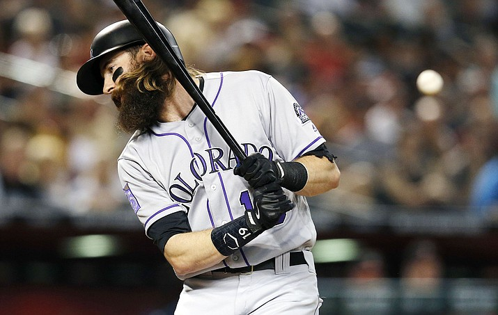 Colorado Rockies' Charlie Blackmon is hit with the pitch by thrown by Arizona Diamondbacks' Patrick Corbin in the third inning during a baseball game, Saturday, Sept. 22, 2018, in Phoenix. (Rick Scuteri/AP)