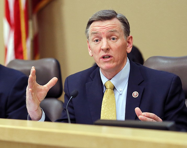 In this Dec. 2013, file photo, U.S. Rep. Paul Gosar, R-Prescott, Ariz., speaks during a Congressional Field Hearing on the Affordable Care Act in Apache Junction, Ariz. Six siblings of Gosar have urged voters to cast their ballots against the Arizona Republican in November 2018 in an unusual political ad sponsored by the rival candidate. The television ad from Democrat David Brill combines video interviews with Gosar-family siblings who ask voters to usher Paul Gosar out of office because he has broken with the family's values. They do not elaborate. (Matt York/AP, File)