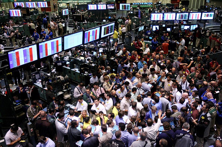 In this Sept. 15, 2008, file photo traders work on the floor of the New York Mercantile Exchange in New York. Home prices had sunk, and foreclosure notices began arriving. Layoffs began to spike. Tremors intensified as Lehman Brothers, a titan of Wall Street, slid into bankruptcy on Sept. 15, 2008. The financial crisis touched off the worst recession since the 1930s Great Depression. (Seth Wenig/AP, File)
