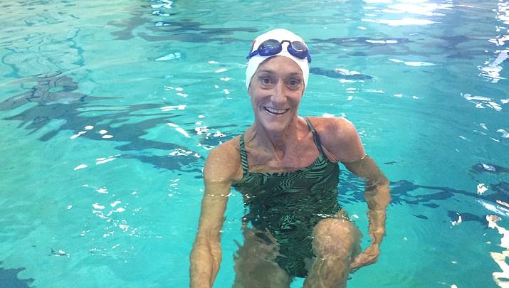 Prescott Masters Swim Team coach 'swims to live, lives  to swim'