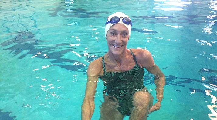 Prescott Masters Swim Team Coach Brigid Bunch, nationally top-ranked 200-meter backstroke medalist, practices her stroke in the deep pool at the Prescott YMCA. (Nanci Hutson/Courier)