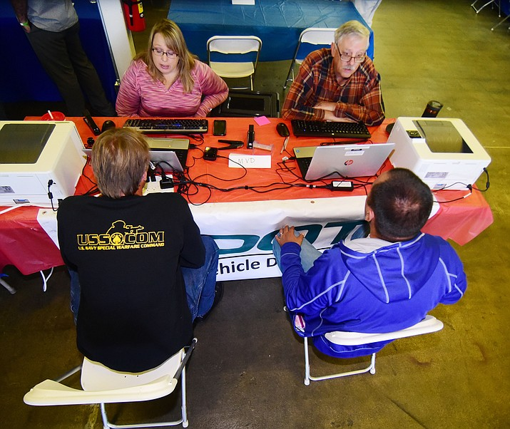 Representatives from the Department of Motor Vehicles help veterans with license or registration problems during the 2017 Veterans Stand Down event at the Frontier Village Shopping Center, Sept. 22, 2017, in Prescott. (Les Stukenberg/Courier file)