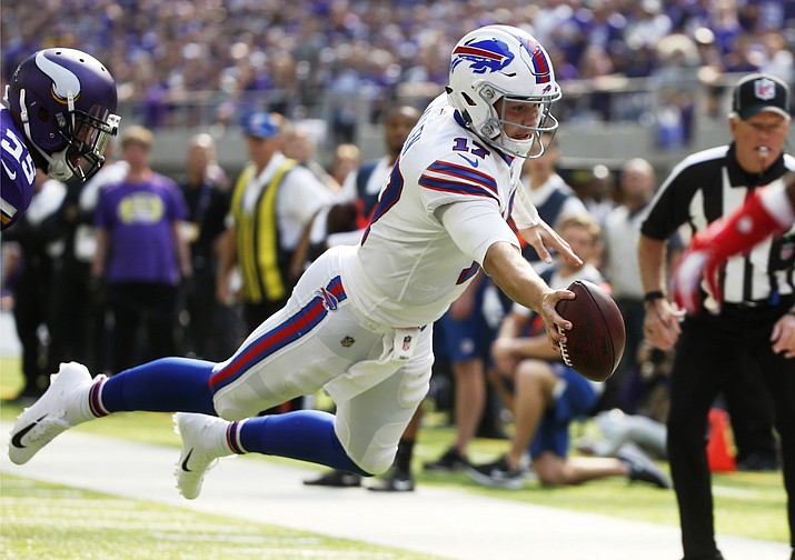 Buffalo Bills quarterback Josh Allen dives to the end zone during a 10-yard touchdown run during the first half of an NFL football game against the Minnesota Vikings, Sunday, Sept. 23, 2018, in Minneapolis. (Bruce Kluckhohn/AP)