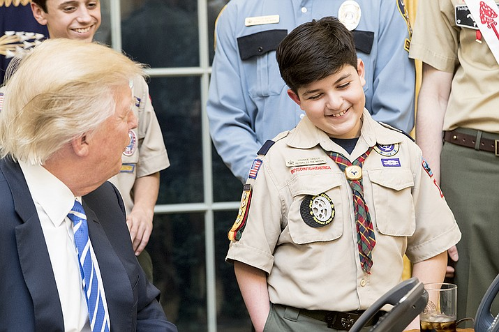 President Donald Trump shares a laugh with a member of the Boy Scouts of America, Tuesday, March 7, 2017, in the Oval Office. (Official White House Photo by Shealah Craighead)