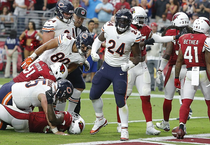 Chicago Bears running back Jordan Howard (24) celebrates his touchdown against the Arizona Cardinals during the second half of an NFL football game, Sunday, Sept. 23, 2018, in Glendale, Ariz. (AP Photo/Rick Scuteri)