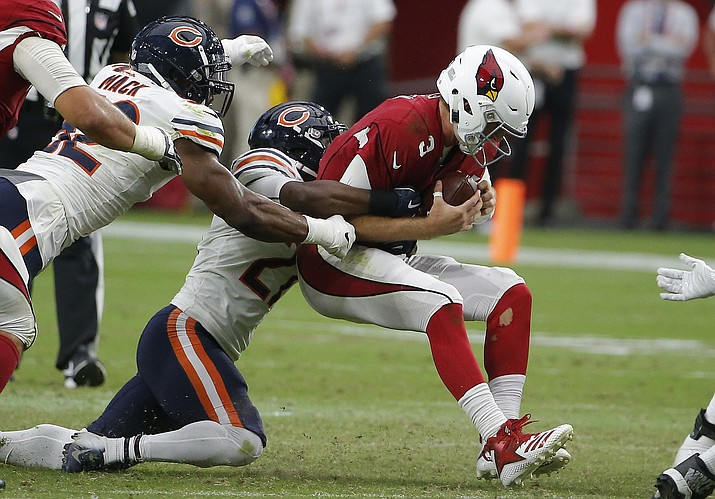 Arizona Cardinals quarterback Josh Rosen (3) gets sacked by Chicago Bears defensive back Sherrick McManis, middle, as Bears linebacker Khalil Mack, left, closes in during the second half of an NFL football game, Sunday, Sept. 23, 2018, in Glendale, Ariz. The Bears defeated the Cardinals 16-14. (Rick Scuteri/AP)