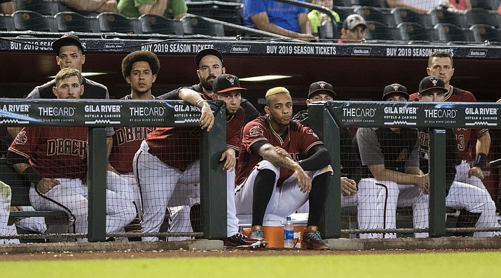 Arizona Diamondbacks players watch the last out of a basseball game against the Colorado Rockies which officially eliminated them from postseason Sunday, Sept 23, 2018, in Phoenix. (Darryl Webb/AP)