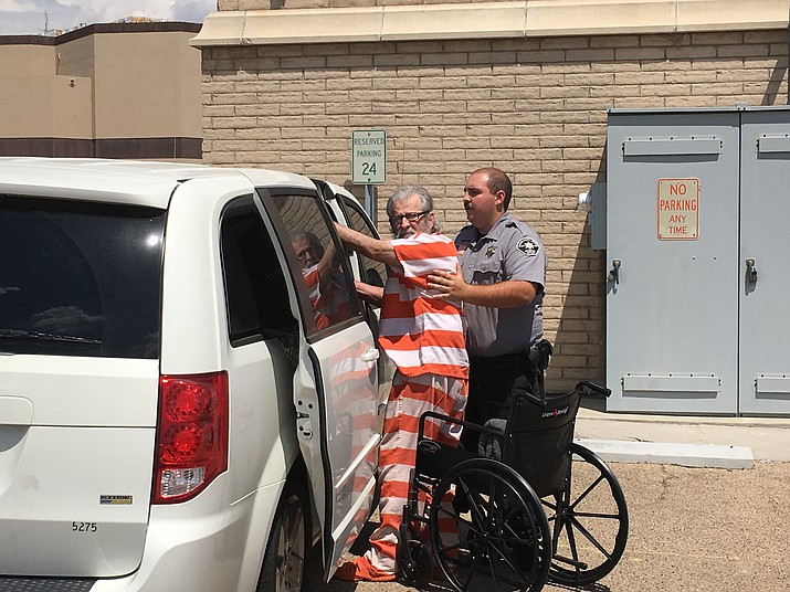 Alfredo Gerardo Blanco, accused of first-degree murder of Sidney Cranston, is helped into a van following a previous court hearing. His trial starts Tuesday. (Daily Miner file photo)