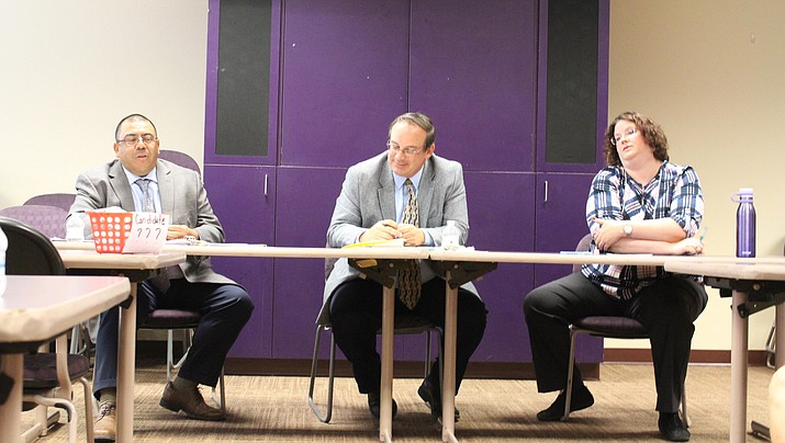 Incumbent Charles Lucero, Cliff Angle, and Jennifer Shumway attended an event Saturday to answer questions from the public about their different views in education. They are three of the four candidates running for Kingman Unified School District school board. (Photo by Vanessa Espinoza/Daily Miner)