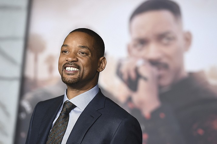 "In this Dec. 13, 2017, file photo, Will Smith arrives at the U.S. premiere of ""Bright"" in Los Angeles. When Smith turns 50 on Tuesday, Sept. 25, 2018, he will jump head-first into the big milestone. The ""Fresh Prince"" plans to bungee jump from a helicopter over a gorge just outside Grand Canyon National Park. His birthday activity is the latest in a vast history of outrageous stunts staged in and around one of the world's seven natural wonders. (Photo by Jordan Strauss/Invision/AP, File)"