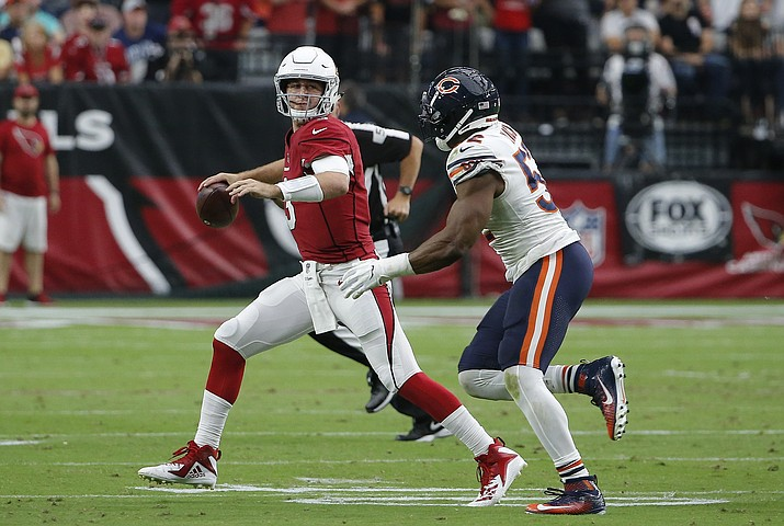 Arizona Cardinals quarterback Josh Rosen, left, looks to throw the ball as he is pressured by Chicago Bears linebacker Khalil Mack, right, during the second half of an NFL football game, Sunday, Sept. 23, 2018, in Glendale. (Rick Scuteri/AP)