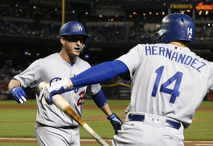 Los Angeles Dodgers' David Freese (25) celebrates his home run against the Arizona Diamondbacks with Enrique Hernandez (14) during the fifth inning of a baseball game, Monday, Sept. 24, 2018, in Phoenix. (Ross D. Franklin/AP)