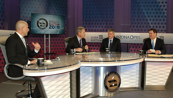 Gubernatorial hopefuls David Garcia, left, Angel Torres to left of host Ted Simons, and incumbent Doug Ducey debate issues Monday night. (Capitol Media Services photo by Howard Fischer)