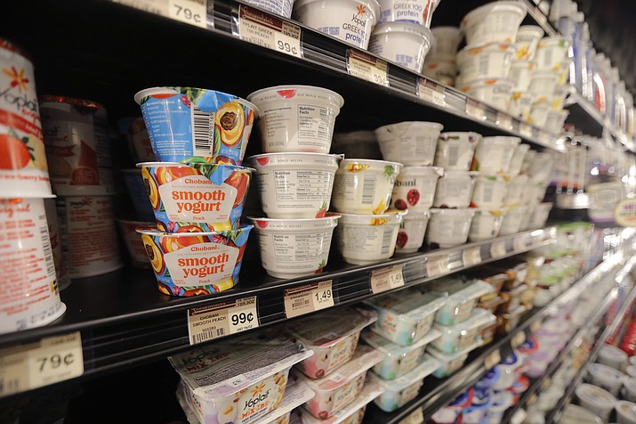 FILE - This July 11, 2018, file photo shows yogurt on display at a grocery store in River Ridge, La. The Food and Drug Administration established a standard for yogurt in 1981 that limited the ingredients. The industry swiftly objected, and the following year the agency suspended enforcement on various provisions, and allowed the addition of preservatives. (AP Photo/Gerald Herbert, File)