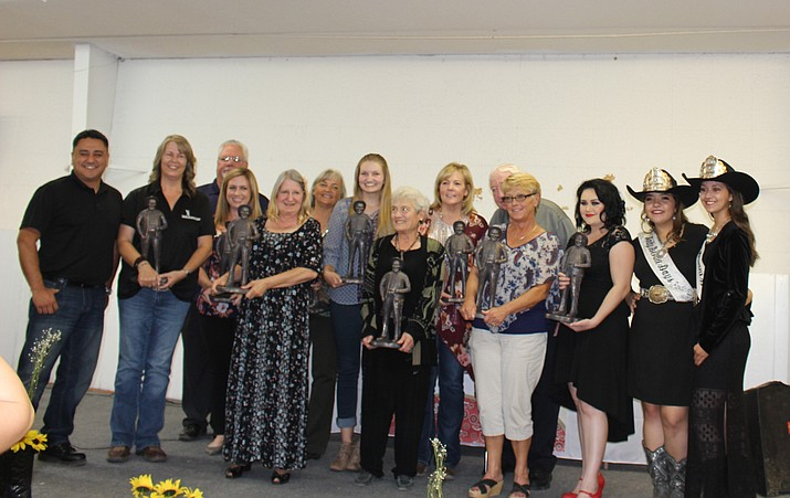 Winners of the 41st annual Andy Awards line up on stage at Mohave County Fairgrounds at the end of Monday's ceremony presented by Kingman Area of Commerce. (Photo by Hubble Ray Smith/Daily Miner)