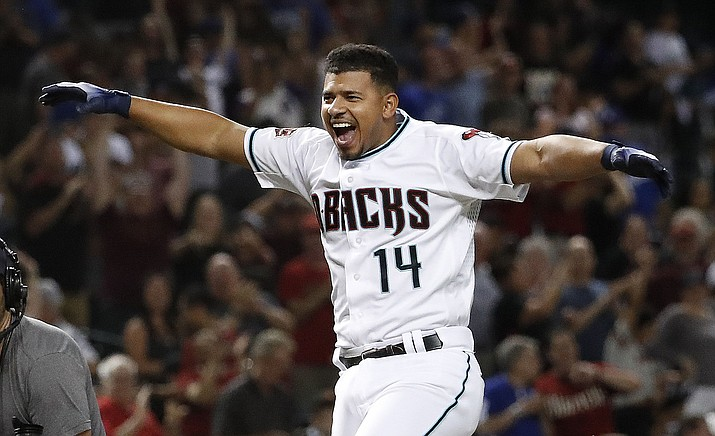 Arizona Diamondbacks' Eduardo Escobar celebrates as he rounds the bases after hitting a walk-off home run against the Los Angeles Dodgers during a baseball game Tuesday, Sept. 25, 2018, in Phoenix. The Diamondbacks won 4-3. (Matt York/AP)