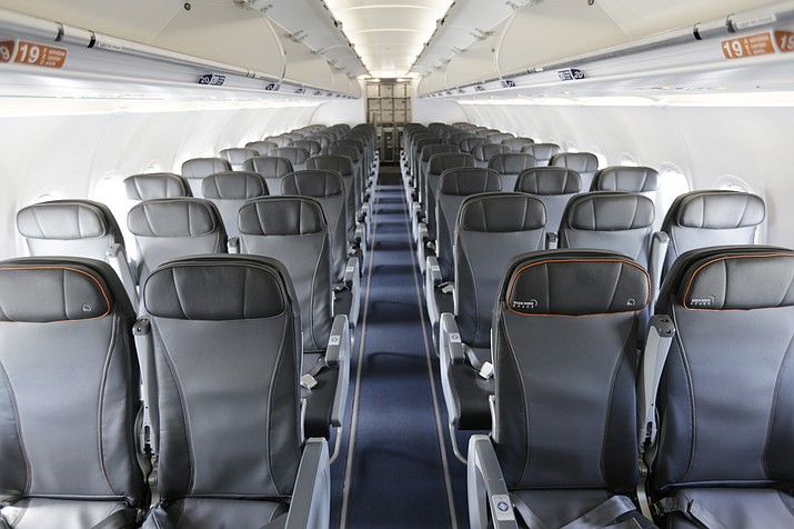 This file photo shows the interior of a commercial airliner at John F. Kennedy International Airport in New York. On Wednesday, Sept. 26, 2018, the House voted to direct the federal government to set a minimum size for airline seats, bar passengers from being kicked off overbooked planes, and consider whether to restrict animals on planes. (Seth Wenig/AP, File)