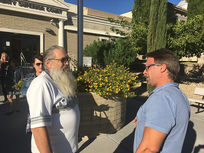 Sid Cranston Sr., left, and his son, Chris, discuss testimony from witnesses on the first day of the first-degree murder trial of Alfredo Blanco outside Mohave County Superior Court Wednesday. Blanco is accused of murdering Sid Cranston Jr. on June 16, 2015. (Photo by Hubble Ray Smith/Daily Miner)