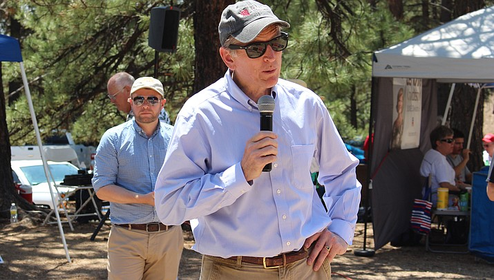 Rep. Paul Gosar speaks to the crowd at this summer's Mohave Republican picnic in the Hualapai Mountains. Six of Gosar's siblings are featured in a campaign ad attacking their brother. (Photo by Vanessa Espinoza/Daily Miner)