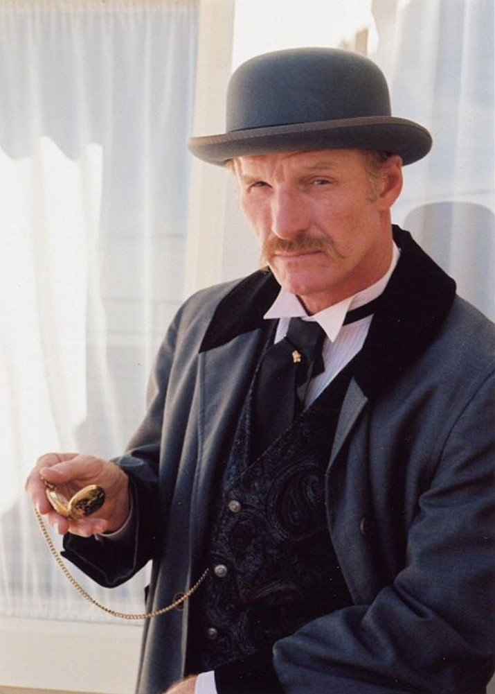 In costume as Doc Holliday, Wyatt Earp checks his gold pocket watch. He'll perform a one-act play about the legendary dentist at 2 p.m. and 7 p.m. Friday at Lee Williams High School. (Courtesy photo)