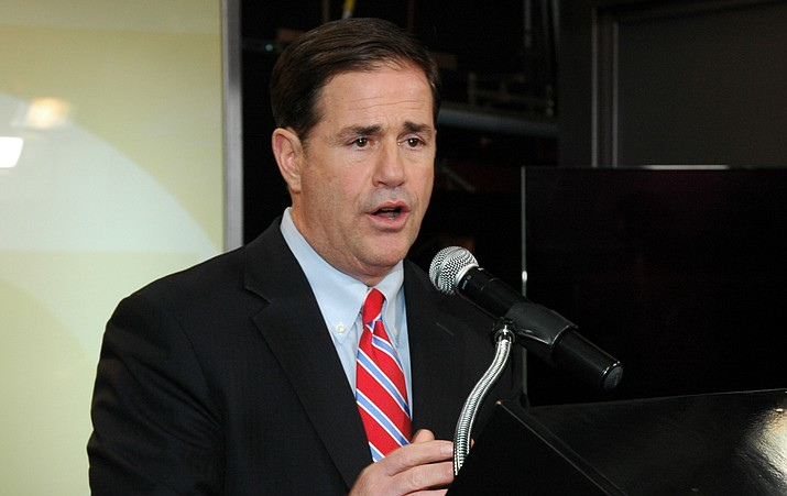 Gov. Doug Ducey speaks to reporters after a debate Tuesday, Sept. 25, in Tucson. (Howard Fischer/Capitol Media Services)