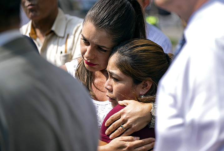 Yeni Gonzalez, a Guatemalan mother who was separated from her three children at the U.S.-Mexico border, lower center, is embraced by volunteer Janey Pearl of Arizona during a news conference Tuesday, July 3, 2018, in New York. Gonzalez saw her children in a New York City facility for the first time since mid May. She was driven cross-country by a team of volunteers after she was released from Eloy Detention Center in Arizona on Thursday. (Craig Ruttle/AP, file)