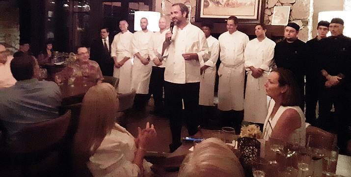 Chef Kevin Binkley introduces his staff.