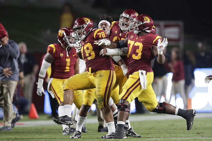 Southern California defensive lineman Jay Tufele (78) and teammates celebrate after Tufele blocked a kick by Washington State punter Blake Mazza during the second half of an NCAA college football game, Friday, Sept. 21, 2018, in Los Angeles. (Jae C. Hong/AP)