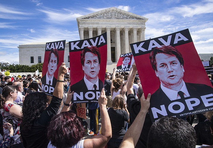 Protesters rally against Supreme Court nominee Judge Brett Kavanaugh as the Senate Judiciary Committee debates his confirmation, Friday, Sept. 28, 2018, at the Supreme Court in Washington. (J. Scott Applewhite/AP)
