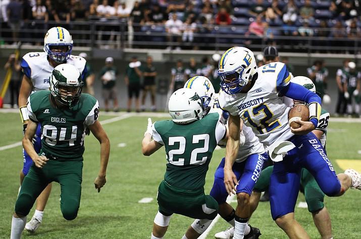 Prescott quarterback Austin Clark (12) runs the ball as the Prescott football team faces Flagstaff on Sept. 15 at the NAU Walkup Skydome in Flagstaff. (Jim Clark/Courtesy, file)