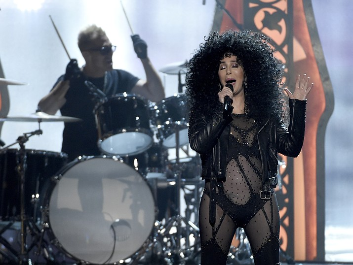 "In this May 21, 2017 file photo, Cher performs at the Billboard Music Awards at the T-Mobile Arena in Las Vegas. In her new release ""Dancing Queen' Cher offers a very deliberate, 10-track collection of classic ABBA songs, including ""Waterloo,"" ""Mamma Mia"" and ""SOS."" Inexplicably, she returns to ""Fernando"" for another swing, having already supplied a version for the film's soundtrack. That one is produced by former ABBA member Benny Andersson; the rest is produced by Cher's longtime collaborator Mark Taylor. (Chris Pizzello, Invision/AP, File)"