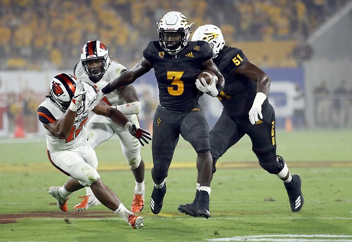 Arizona State running back Eno Benjamin (3) runs against Oregon State during the first half of an NCAA college football game, Saturday, Sept. 29, 2018, in Tempe, Ariz. (Matt York/AP)