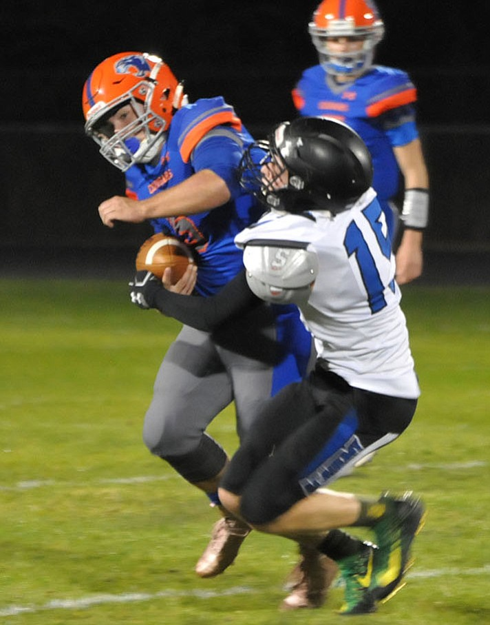 Kingman Academy's Connor Alleman makes a tackle Friday night at Chino Valley. (Photo by Jason Wheeler/Prescott Daily Courier)