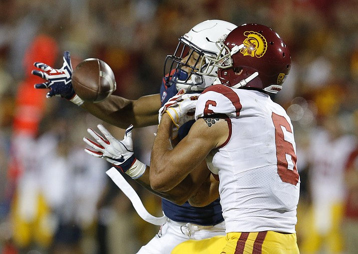 Arizona safety Scottie Young Jr. breaks up the pass intended for Southern California wide receiver Michael Pittman Jr. (6) in the first half during an NCAA college football game, Saturday, Sept. 29, 2018, in Tucson, Ariz. (Rick Scuteri/AP)