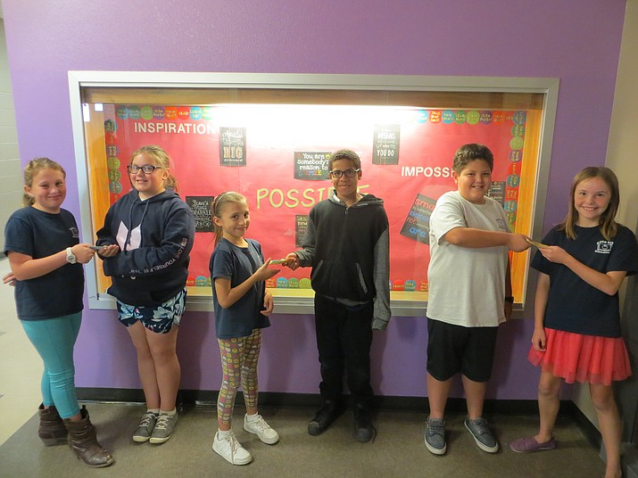 Pictured here are winners from left to right. Autumn Ostermeyer (age 11), Grace Baker (age 10), Yareli Lozano (Age 9). A.J. Dowling (age 10), Alonso Barocio (age 10), and Ava Childers (age 10).