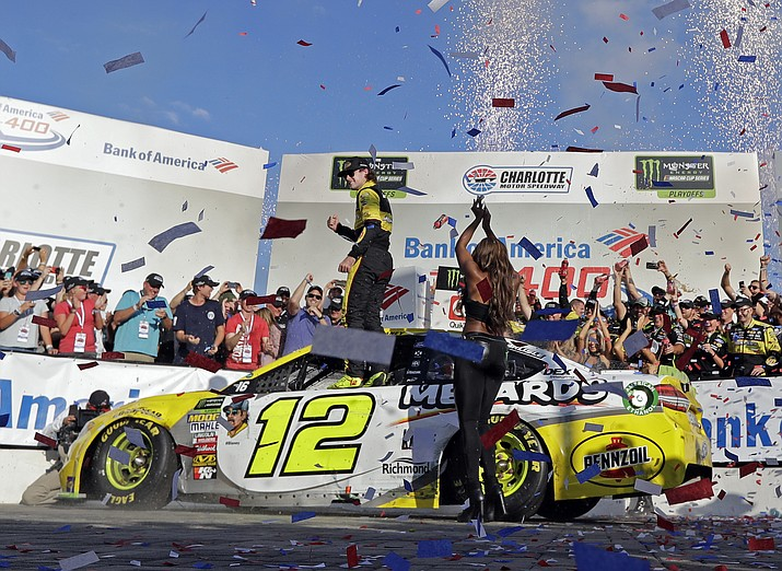 Ryan Blaney celebrates in Victory Lane after winning the NASCAR Cup series race at Charlotte Motor Speedway in Concord, N.C., Sunday, Sept. 30, 2018. (Chuck Burton/AP)