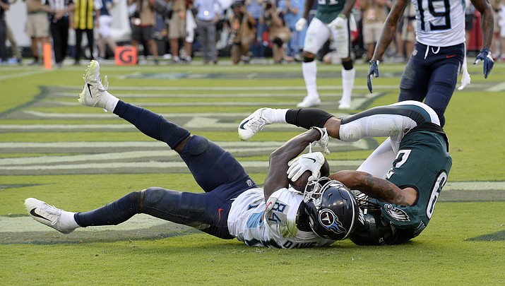 Tennessee Titans wide receiver Corey Davis catches the winning touchdown pass against Philadelphia Eagles cornerback Avonte Maddox in overtime of an Sunday's game in Nashville, Tenn. The Titans won 26-23. (Mark Zaleski/AP)