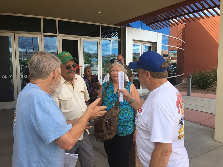 Mike Barnes, right, vice president of Hualapai Four Wheelers, talks with a group of off-road enthusiasts outside the County Administration Building Monday following the Board of Supervisors' vote to form a citizens' advisory commission for public lands recreation. (Photo by Hubble Ray Smith/Daily Miner)